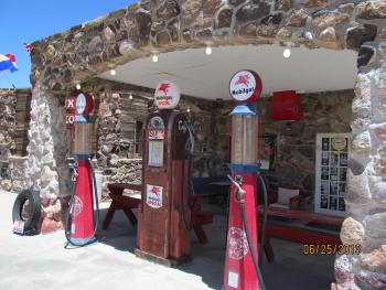 The Cool Springs site offered food, gas, and cabins for Route 66 travelers in its heyday. A fire destroyed all but some stone foundation and stone pillars in the 1960s. It was rebuilt and reopened as a gift and snack shop in 2005 on Route 66 in Arizona. Photo by Lynda Schmitz Fuhrig.