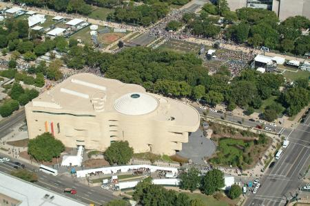 Aerial view of the National Museum of the American Indian from September 21, 2004, by Carl C. Hansen, Accession 11-019 - Smithsonian Photographic Services Collection, Smithsonian Institution Archives, neg. no. 2004-53062.