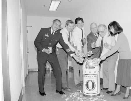 The Smithsonian's pilot aluminum-can recycling program started early in February 1990 when forty-four containers like the one pictured were placed at the National Museum of American History The US Department of State will use this photo on its internal website. Accession 98-015 - Office of Public Affairs, The Torch, 1989-1994, Smithsonian Institution Archives, Neg. No. 89-21916-8.