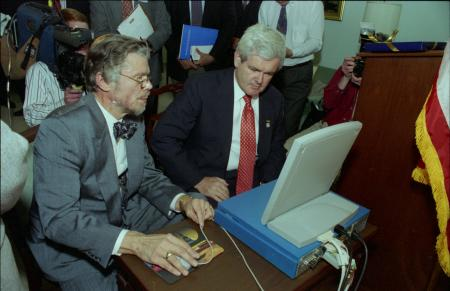 Smithsonian Institution website launch with Speaker of the House Newt Gingrich and Peter House, chief analyst and director of the Policy Research and Analysis staff at the National Science Foundation, who was detailed to the Smithsonian's Office of Information Technology to create the website, in the U.S. Capitol Building, May 8, 1995, by Eric Long, Accession 11-009, Smithsonian Institution Archives, neg. no. 95-3642-10.