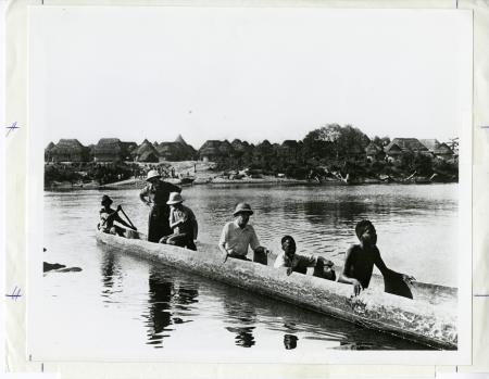 Dr. William M. Mann (third from right), director of the National Zoo from 1925 to 1956, and his wife, Lucy (standing), are in a canoe with native people as they cross St. Paul's River near Dobli's Island, Liberia, in 1940. Smithsonian Institution Archives, Image Number SIA2011-1031.