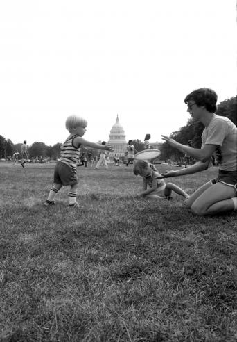 National Air and Space Museum Frisbee Day, September 4, 1977, by Richard Hofmeister, Accession 11-009, Smithsonian Photographic Services, Photographic Collection, 1971-2006, Smithsonian Institution Archives, neg. no. 77-12428-10A.