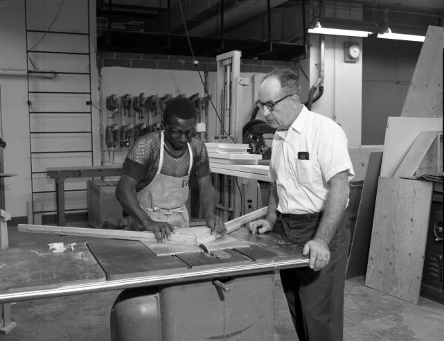 Office of Exhibits Staff Cutting Materials for Displays, circa 1960s, black and white negative.