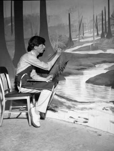 Office of Exhibits Staff Member Painting Exhibit Background, circa 1960s, by Jack Scott, black and white negative.