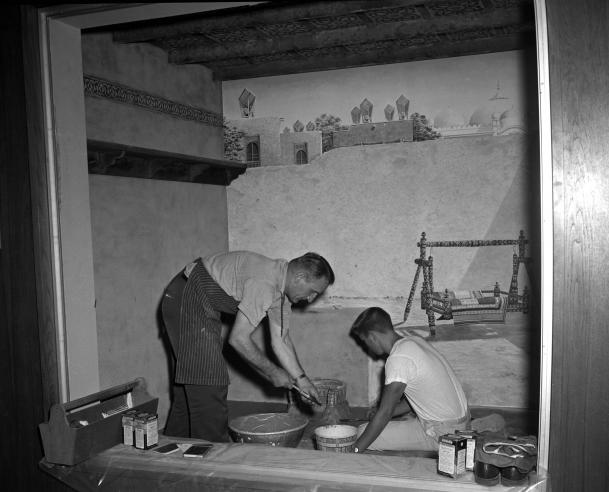 Office of Exhibits Staff Making Floor for Exhibit Display, circa 1960s, by Jack Scott, black and white negative.