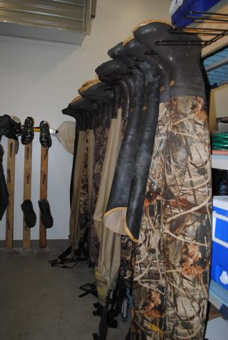 Rack of boots used in the wetlands at the Smithsonian Environmental Research Center. Photo by Kira Sobers, September 12, 2015.