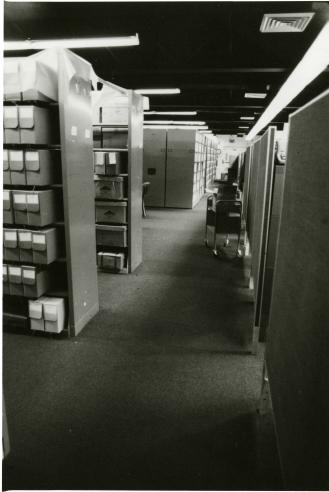 Smithsonian Institution Archives located on the second floor, northeast section, of the Arts and Industries Building. The stack range, storage, and cubicle work station area are shown here, 1979. Record Unit 95, Smithsonian Institution Archives, Neg. no. SIA2011-1487.