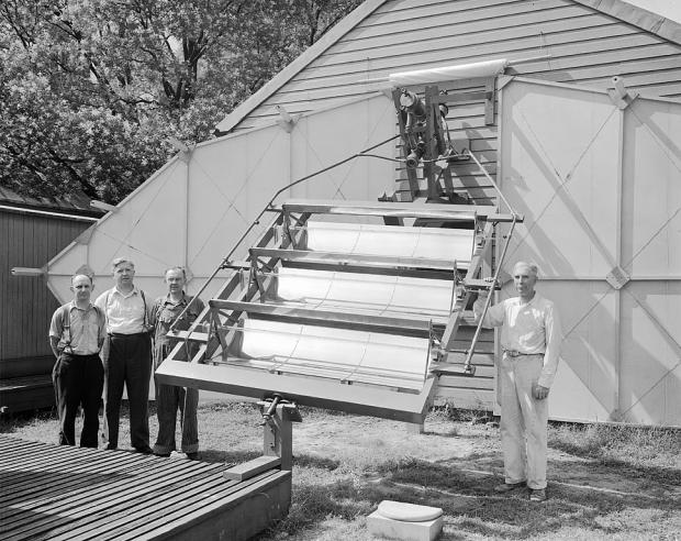 Secretary Charles G. Abbot with Solar Boiler, South Yard, Smithsonian Castle, 1936.
