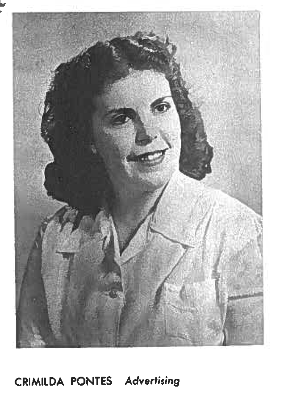 Grainy black and white yearbook photo. Crimilda is looking to the left. Her hair is shoulder length,