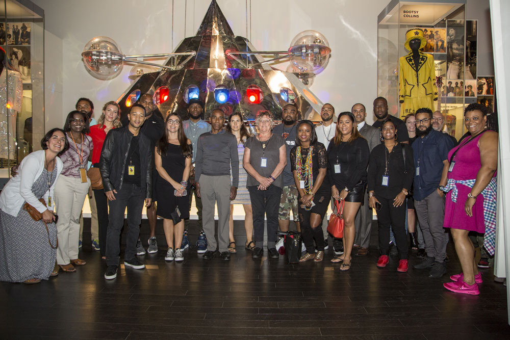 Group in front of metal spaceship with lights.