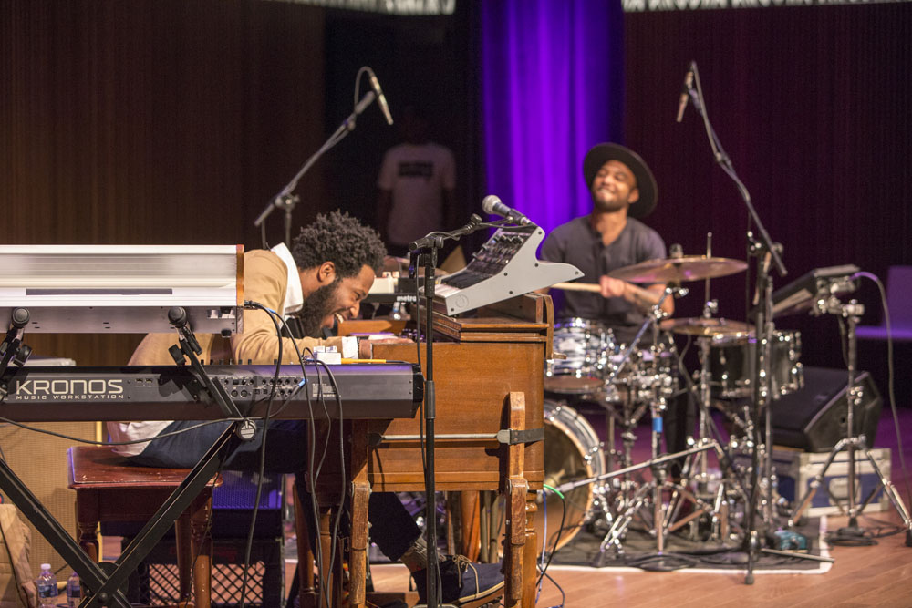 A piano player and drummer performing.