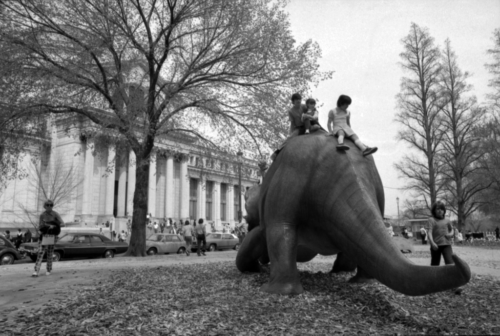 Children play on the model. Also in view is the Natural History Museum.