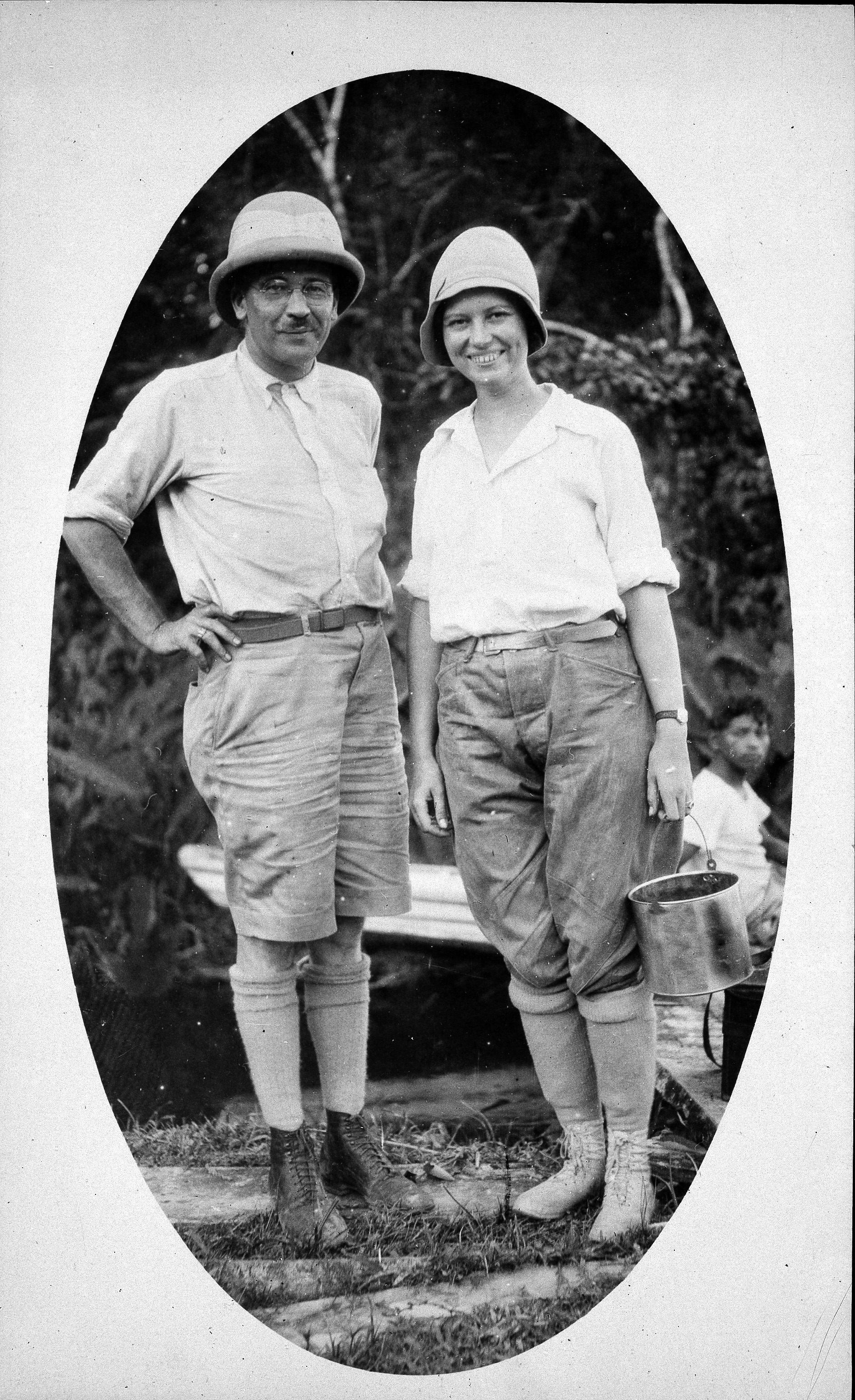 William and Lucile Quarry Mann in the field. Both are wearing hats and high socks.