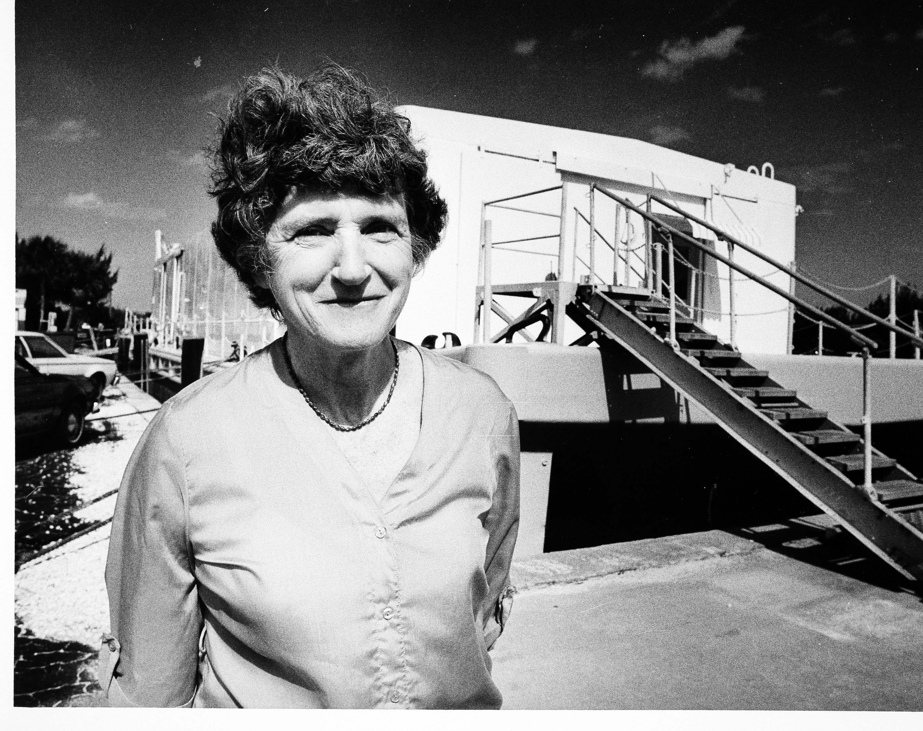 Portrait of Mary Rice in front of a trailer with stairs.