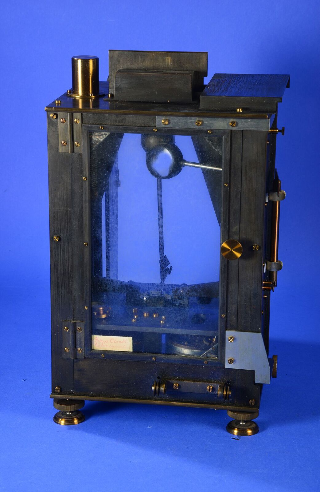 Color photo of a scientific instrument in front of a blue background, instrument is similar in appea