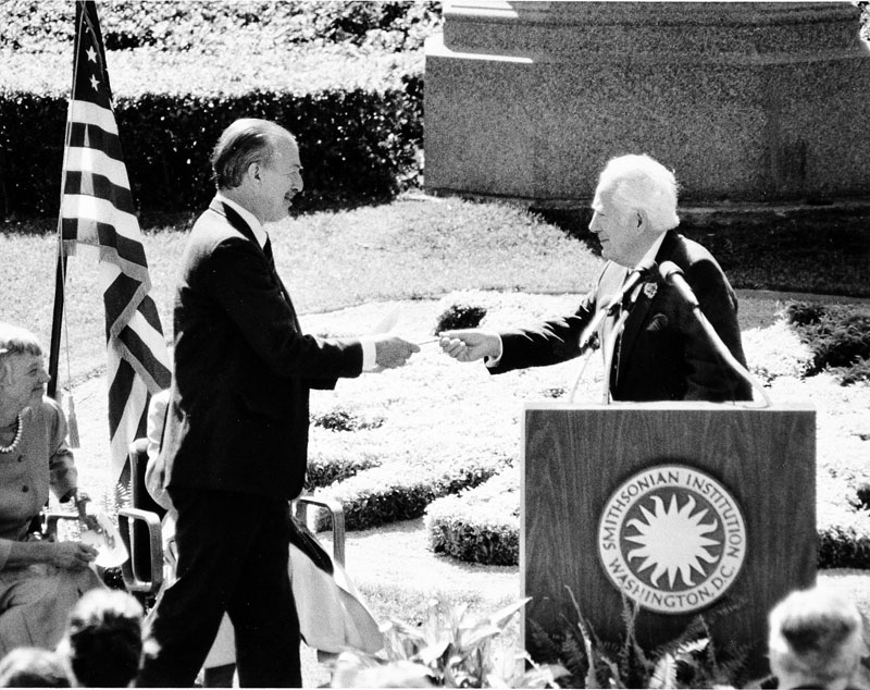 Chief Justice Warren Burger hands key to the