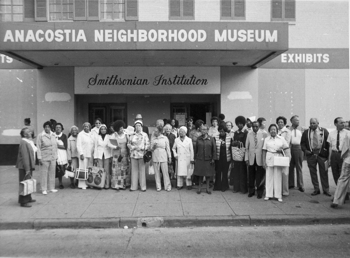 Members of the Anacostia Historical Society pose in front of the original Anacostia Neighborhood Museum, which opened in the renovated Carver Theater.  Smithsonian Institution Archives, Record Unit 371, Box 2, Folder September 1977.