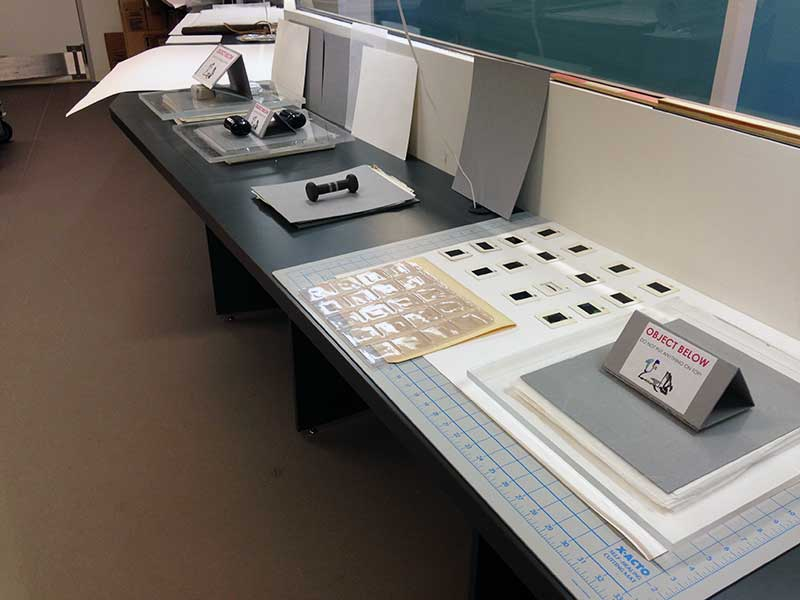 Slides, documents, and folders on a table