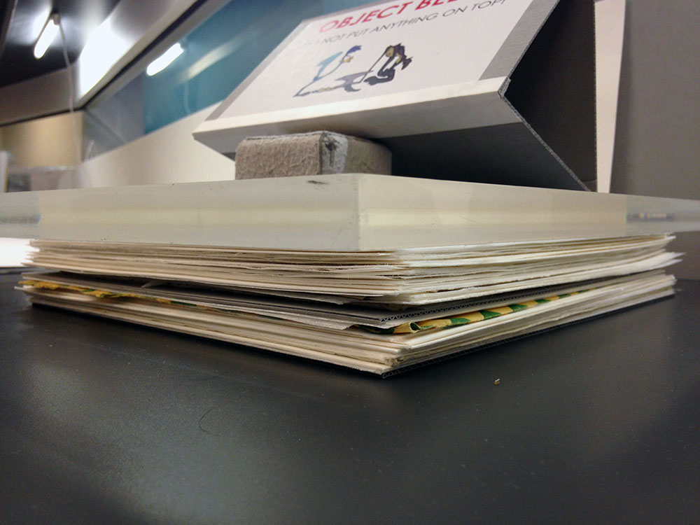 Stack of paper interwoven with blue boards