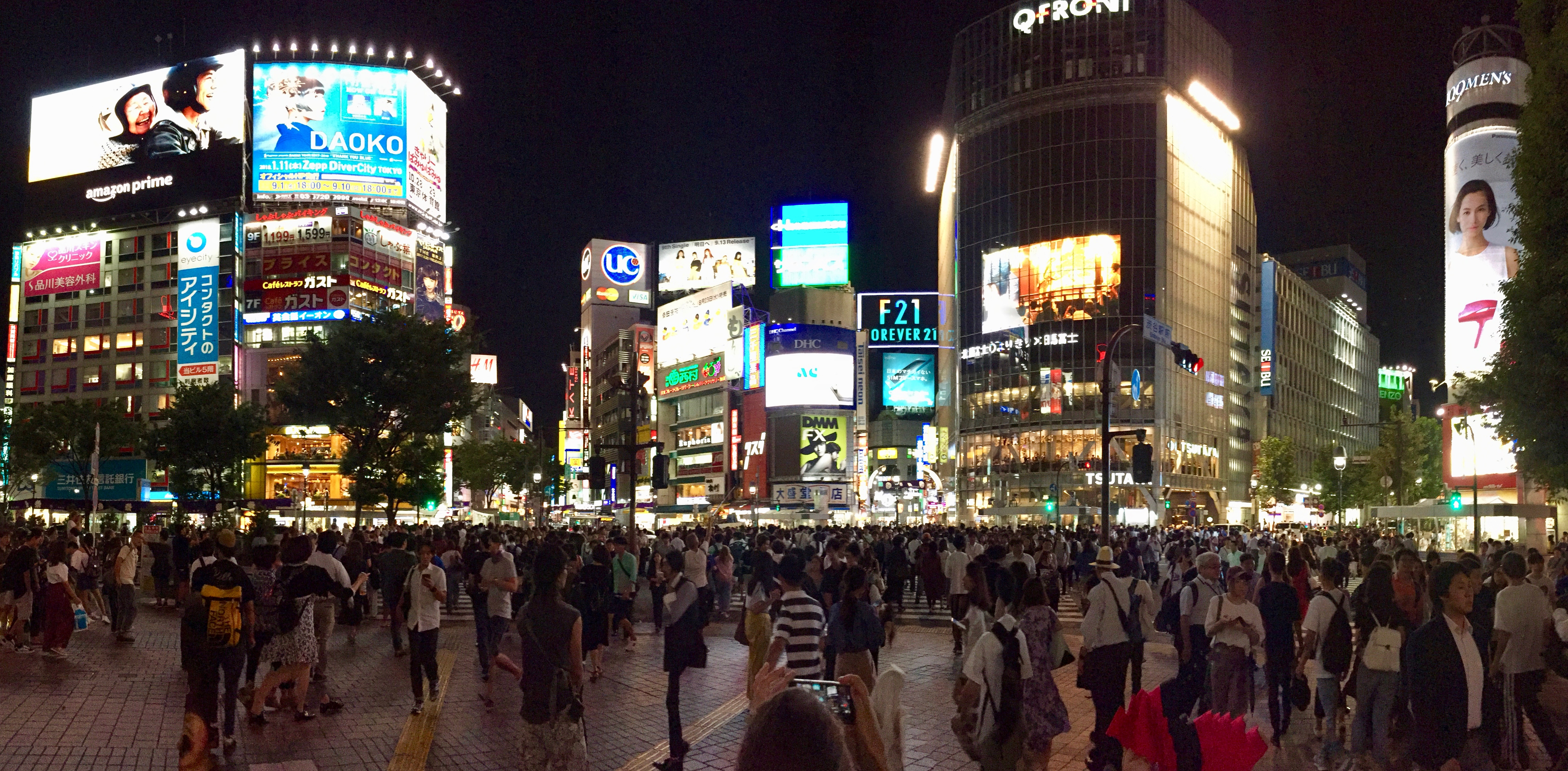 Large group of people in city at night.