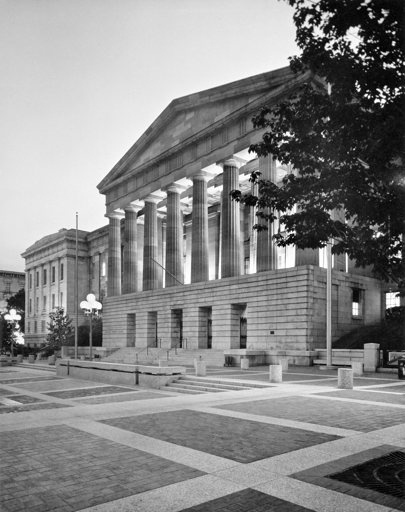 From the southeast, an evening view of the exterior of the National Portrait Gallery's side of the American Art and Portrait Galleries' building. Smithsonian Institution Archives, Record Unit 371, Box 2, Folder: October 1978.