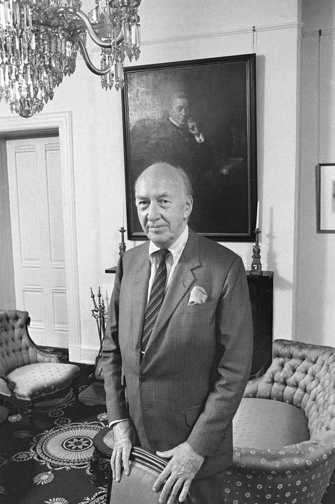 S. Dillon Ripley, eighth Smithsonian Secretary, standing in the Secretary's Parlor in the Smithsonian Institution Building in front of the portrait of Joseph Henry, first Secretary of the Smithsonian.  Smithsonian Institution Archives, Accession 97-003.
