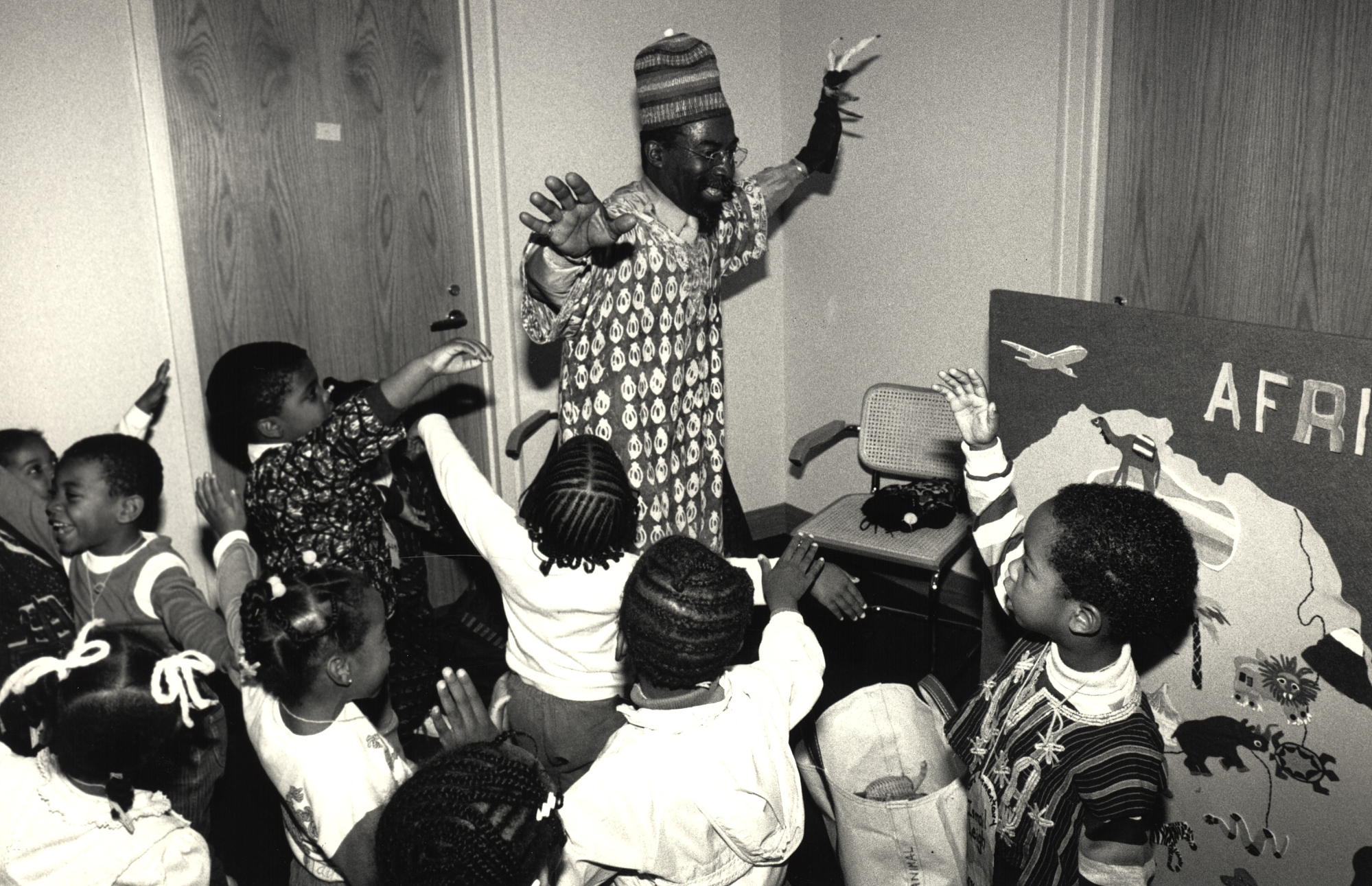 Volunteer docent James Brown, Jr. introduces preschoolers to the art of Africa at the National Museum of African Art (NMAfA), 1988. With the help of his puppet friend Kaboundi Gazelle, Brown helps children investigate shapes, learn games, play music and listen to folk tales.