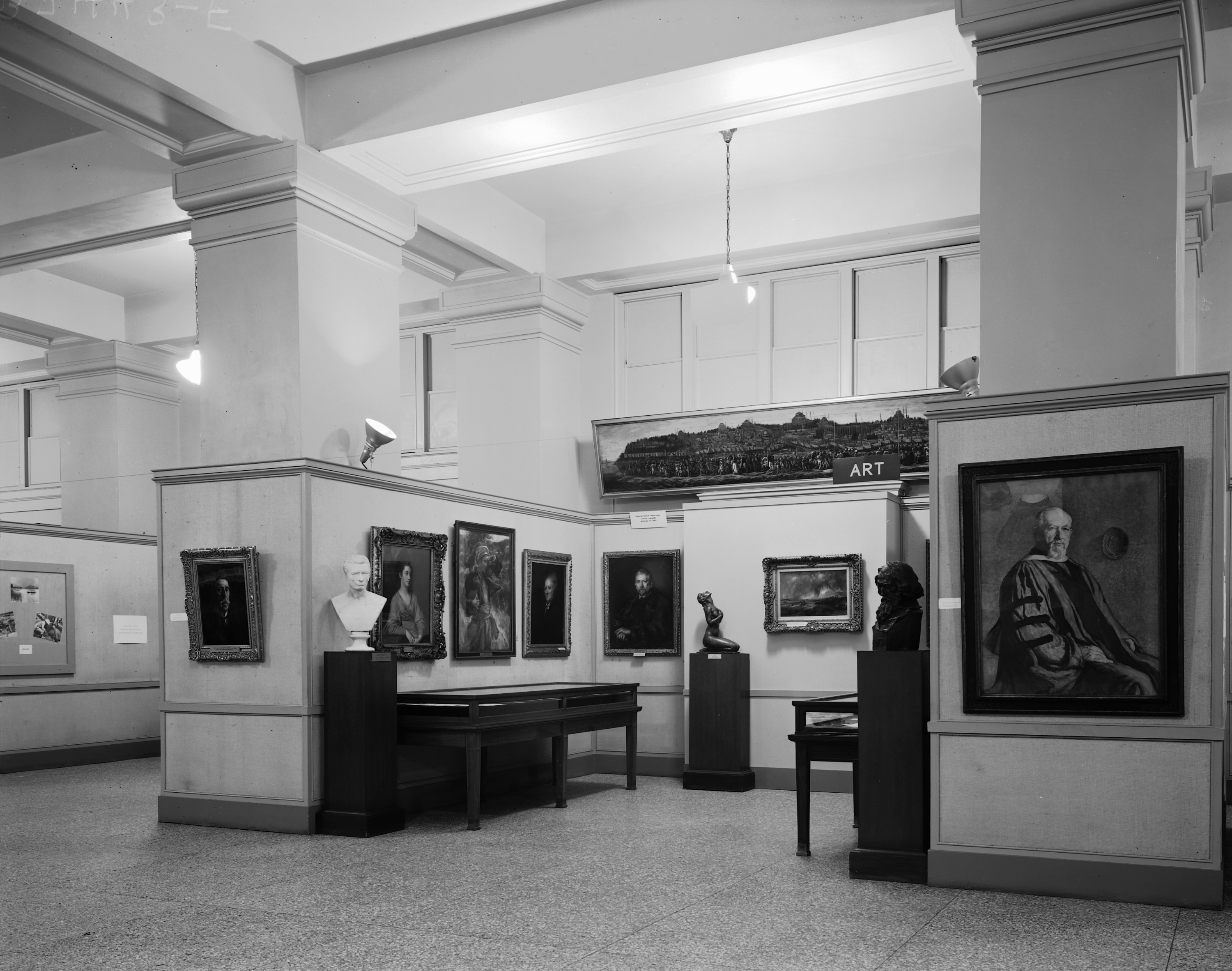 Section about the history of art collecting activities that features portraits, busts, and a sculptu