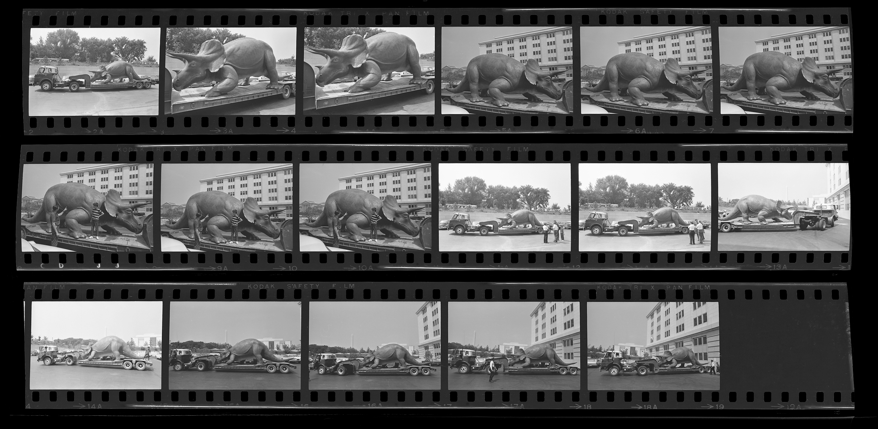 Three strips of negatives of Uncle Beazley on a flatbed truck.