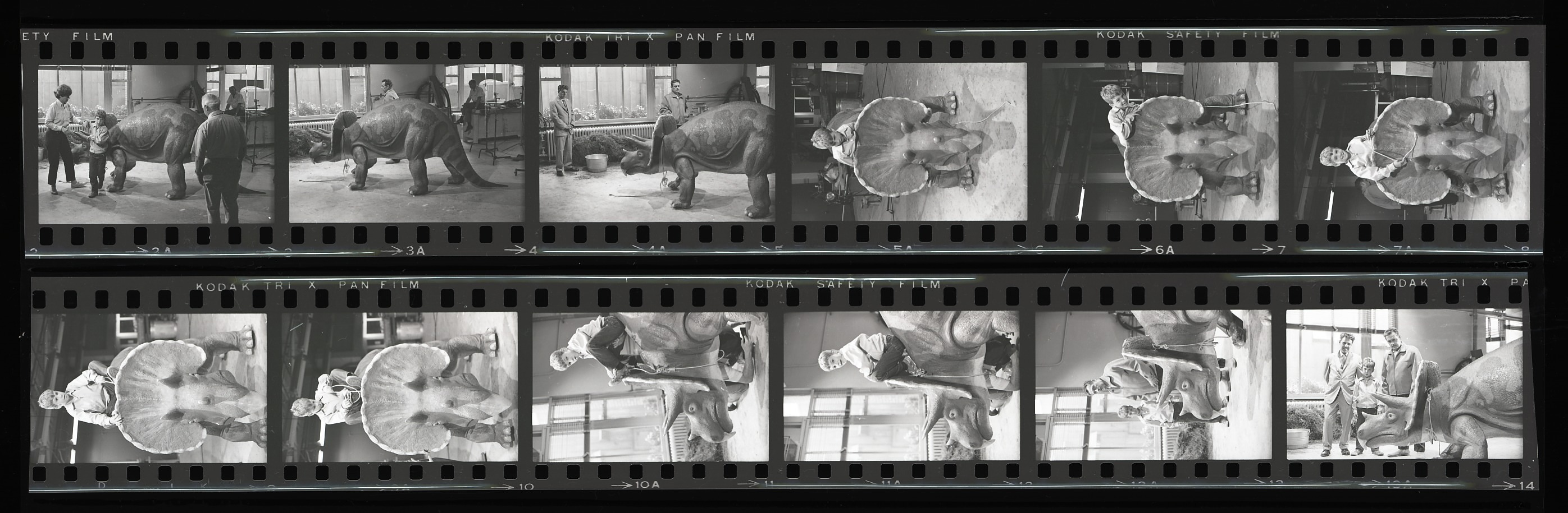 Negative strips of a boy riding Uncle Beazley. Men stand nearby.