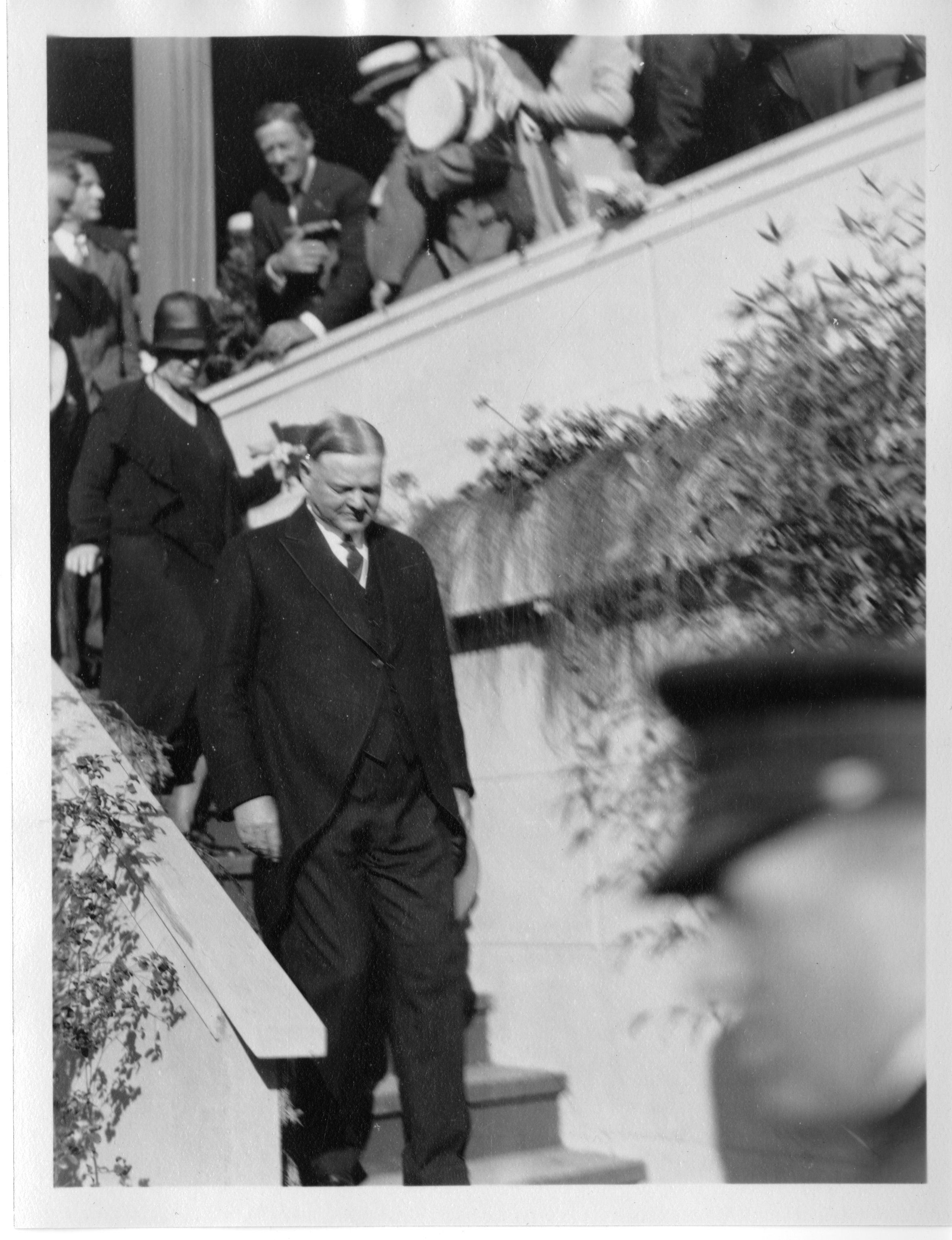 Hoover leaving the platform with his wife Lou Henry