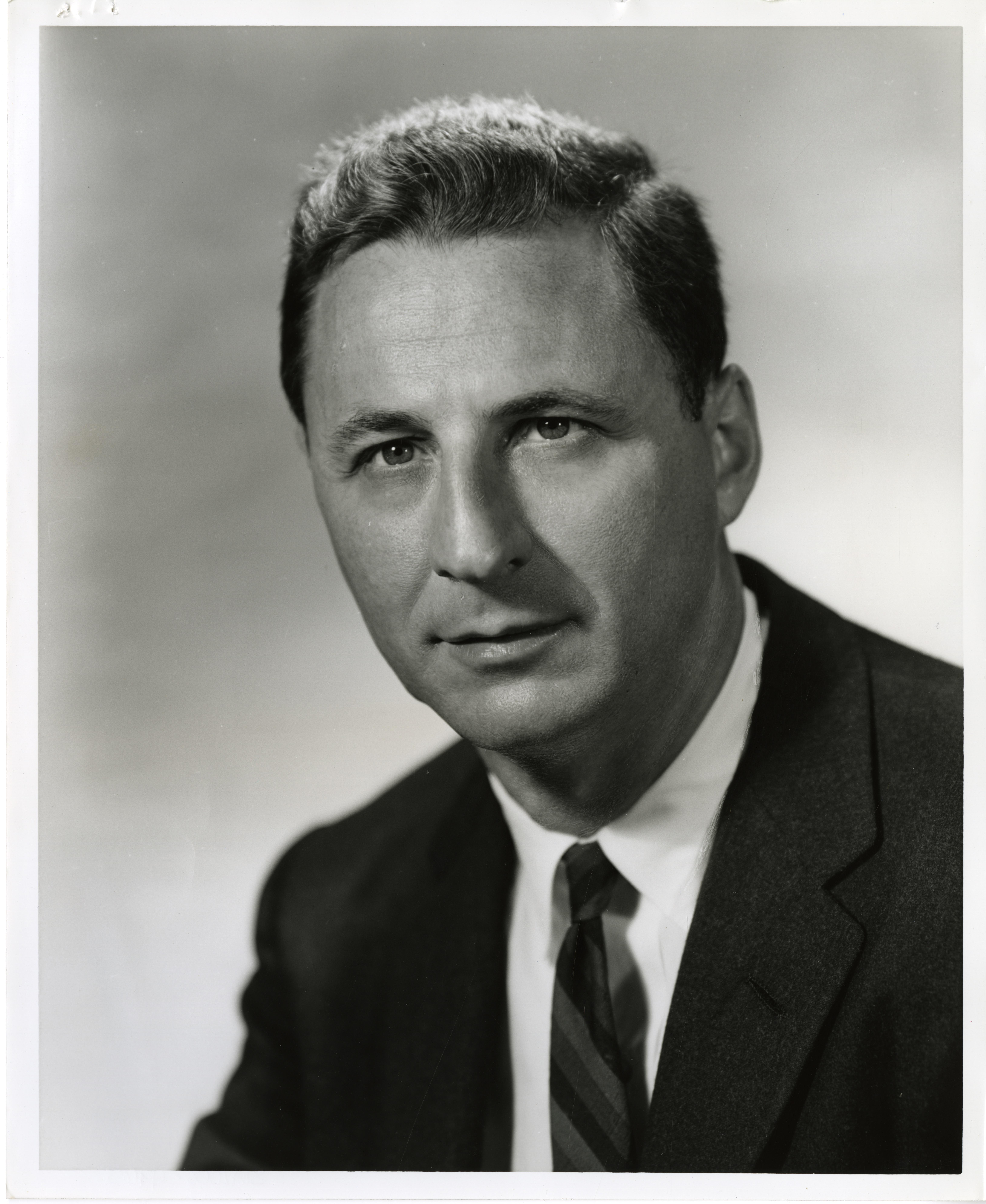 Portrait photograph of a man in a suit.