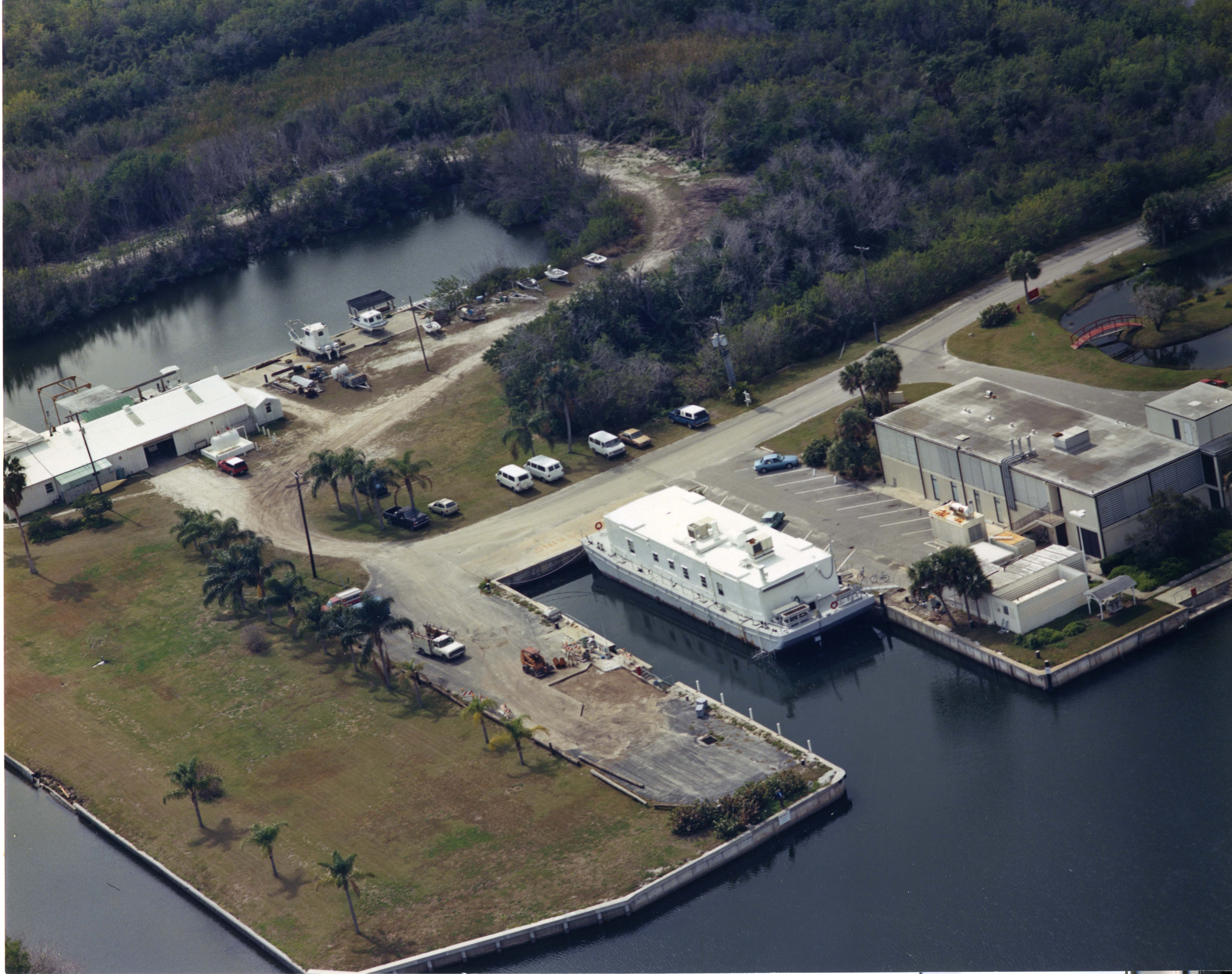 Aerial view of the Marine Station at Fort Pierce. It is right on the water. Palm trees are also visi