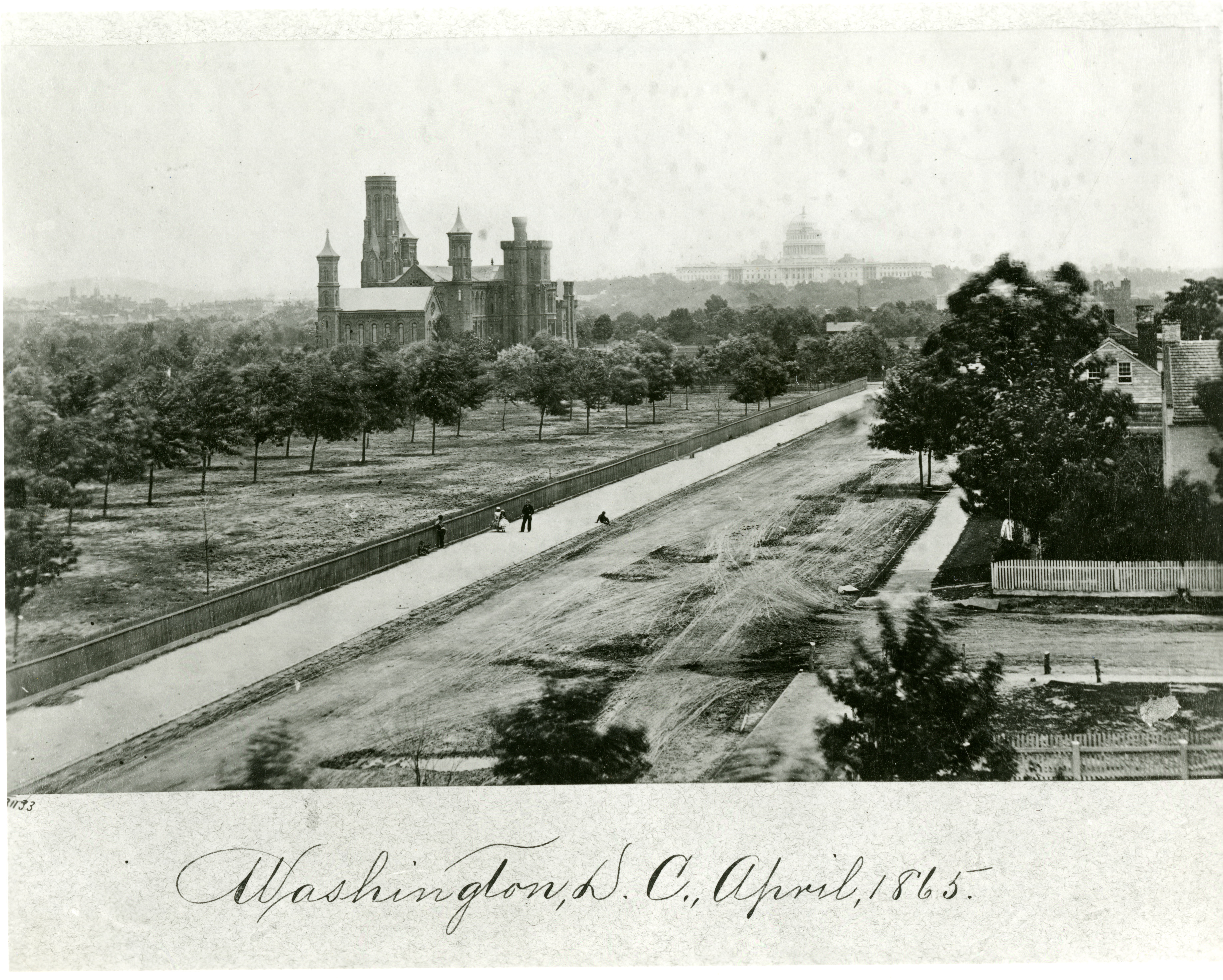 View of the Smithsonian Institution Building with a dirt road.