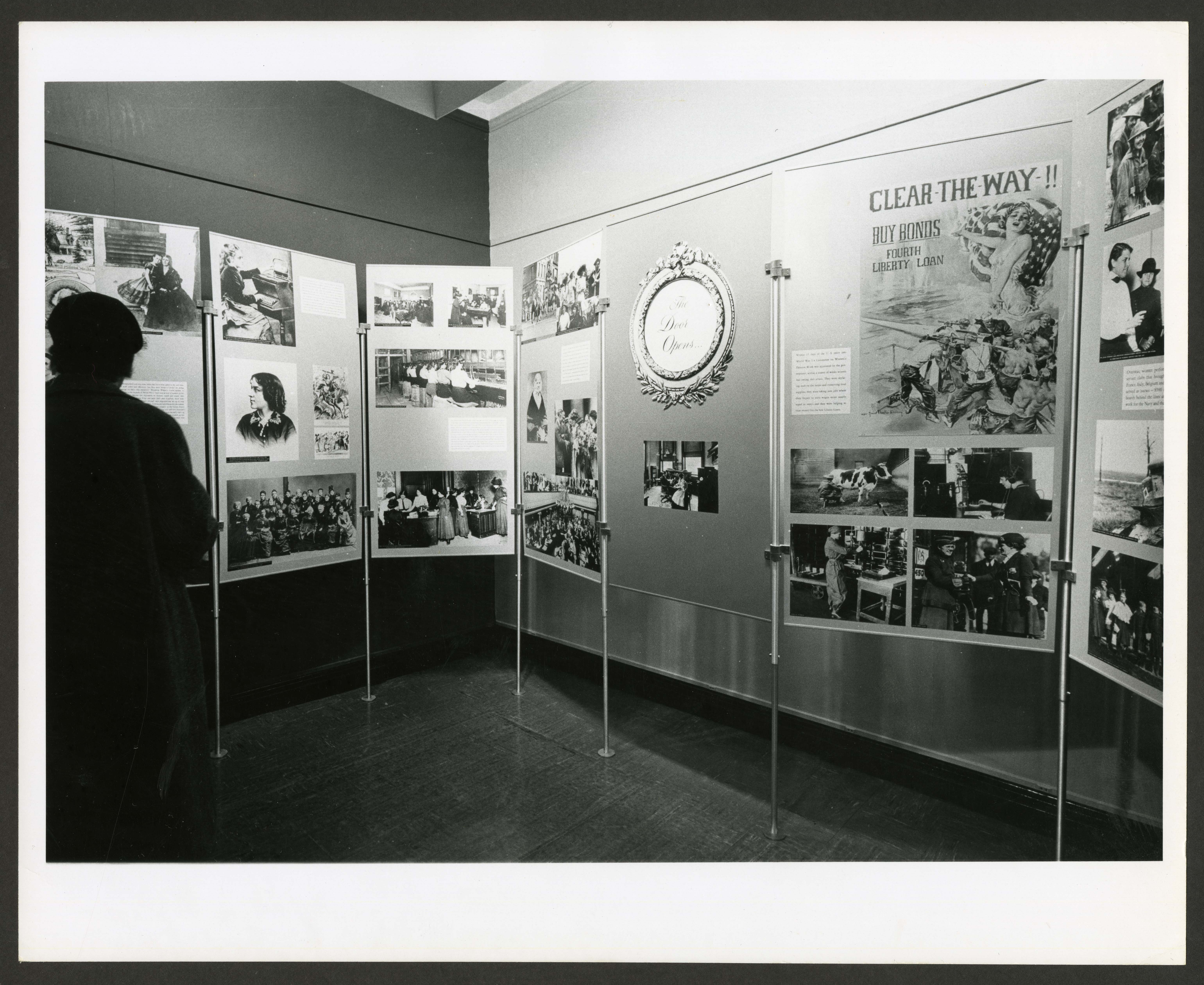 B & W image of seven museum panels, one panel states in bold letters Clear the Way.