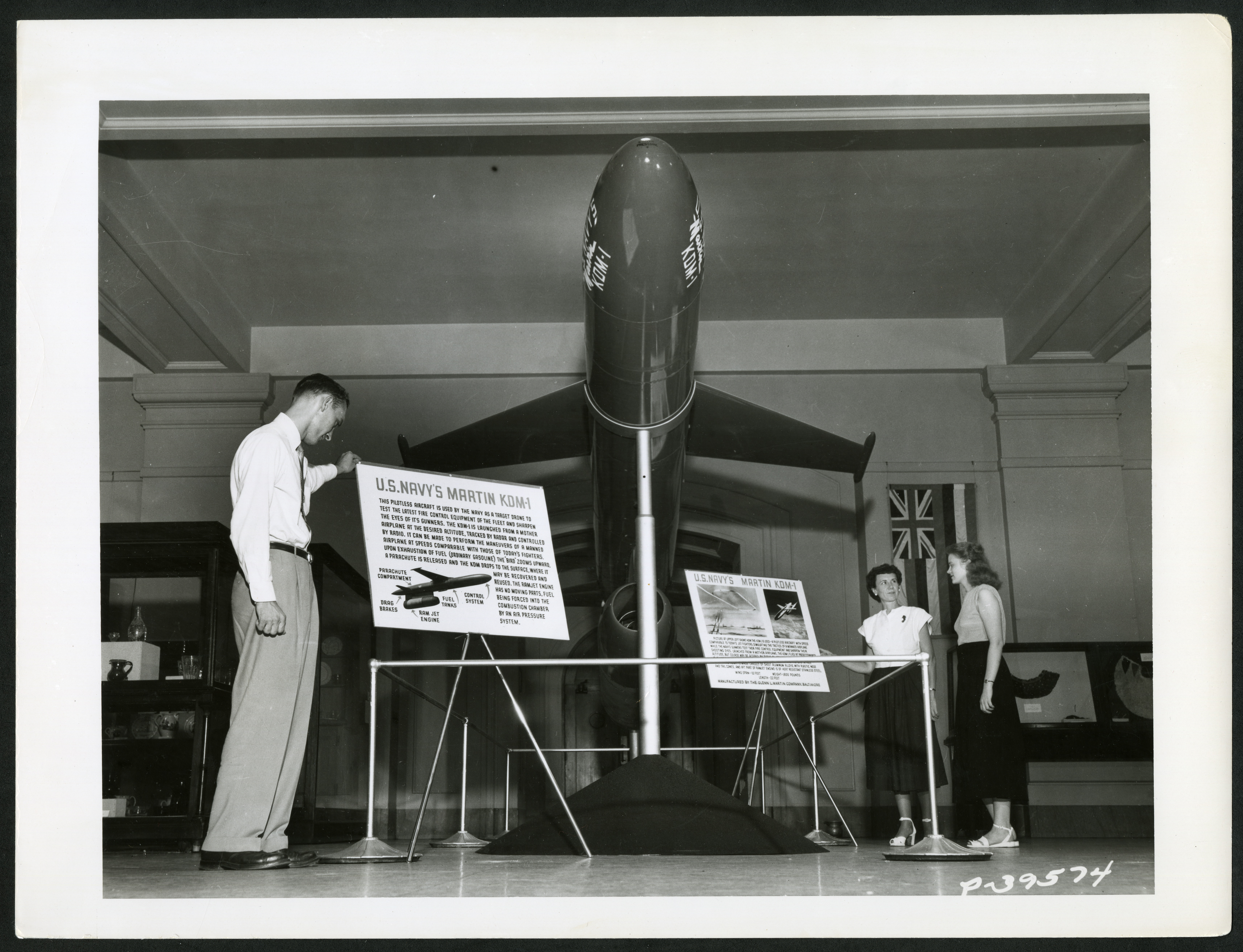 Exhibit displays the U.S. Navy's Martin KDM-1 target drone, with a man standing to the left, and Hel