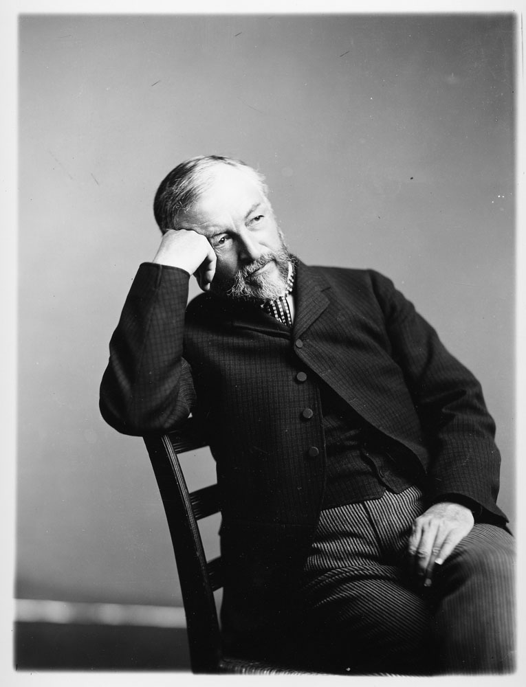 Portrait of Samuel P. Langley sitting in a chair.  Smithsonian Institution Archives, Record Unit 95, Box 15, Folder 8, Neg. # 2002-12175.