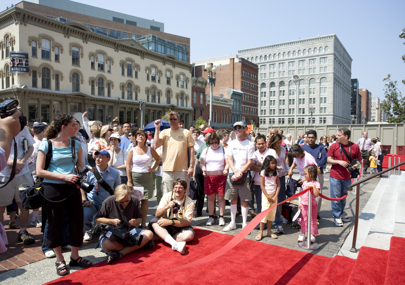 Adults and children stand outside the Donald W. Reynolds Center for American Art and Portraiture bui