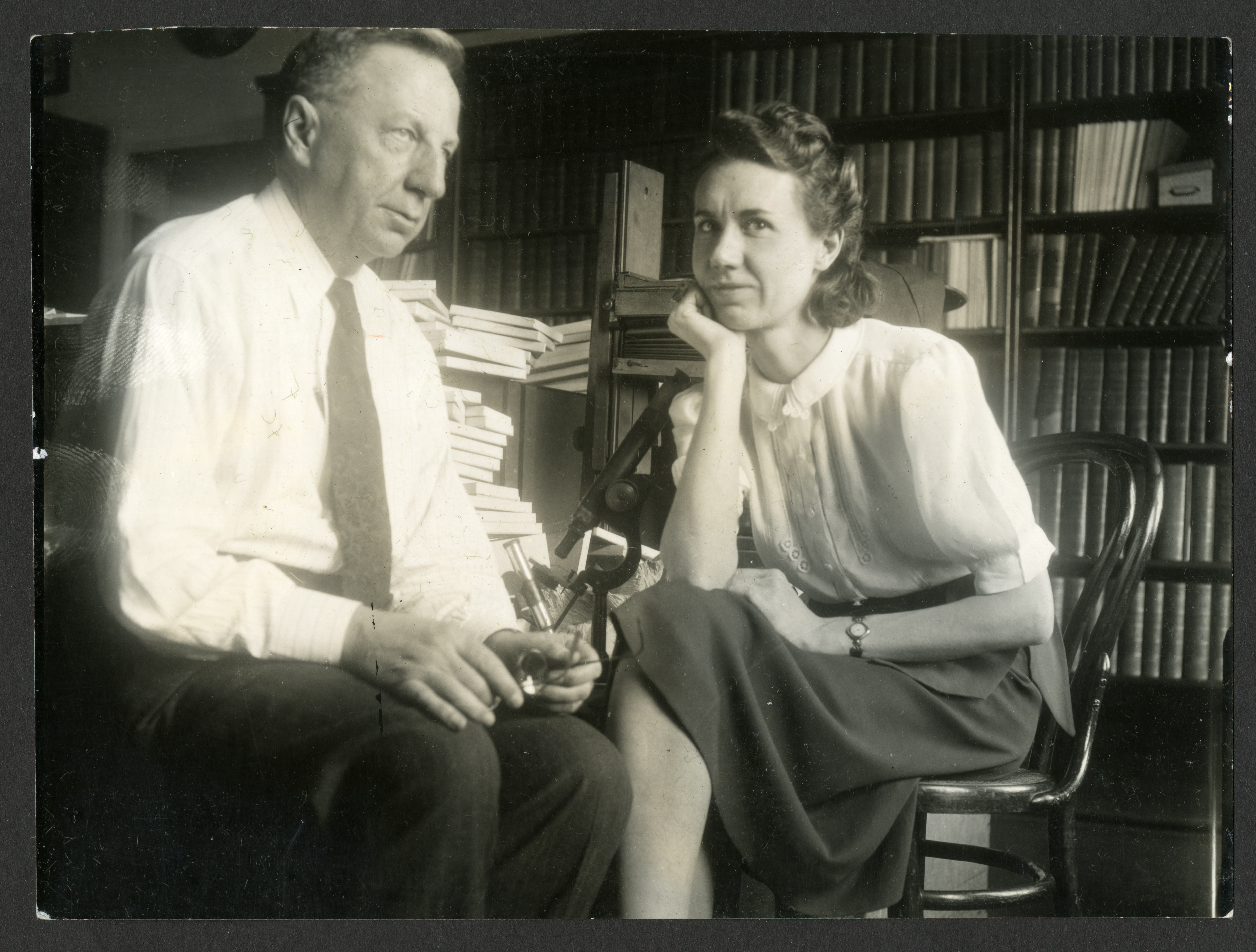 Helena Weiss with Dr. Ray Bassler in the Natural History Building office, c. 1930s or 1940s
