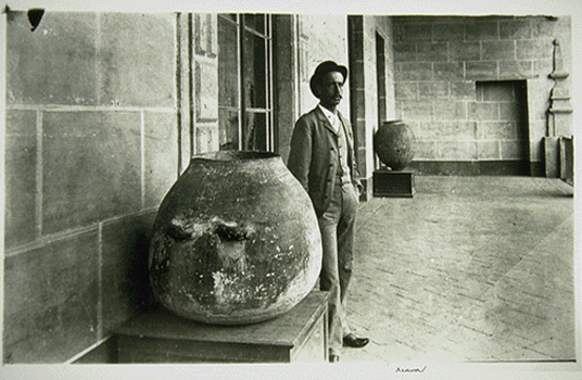 Holmes standing next to an artifact in the Museo Nacional De Mexico
