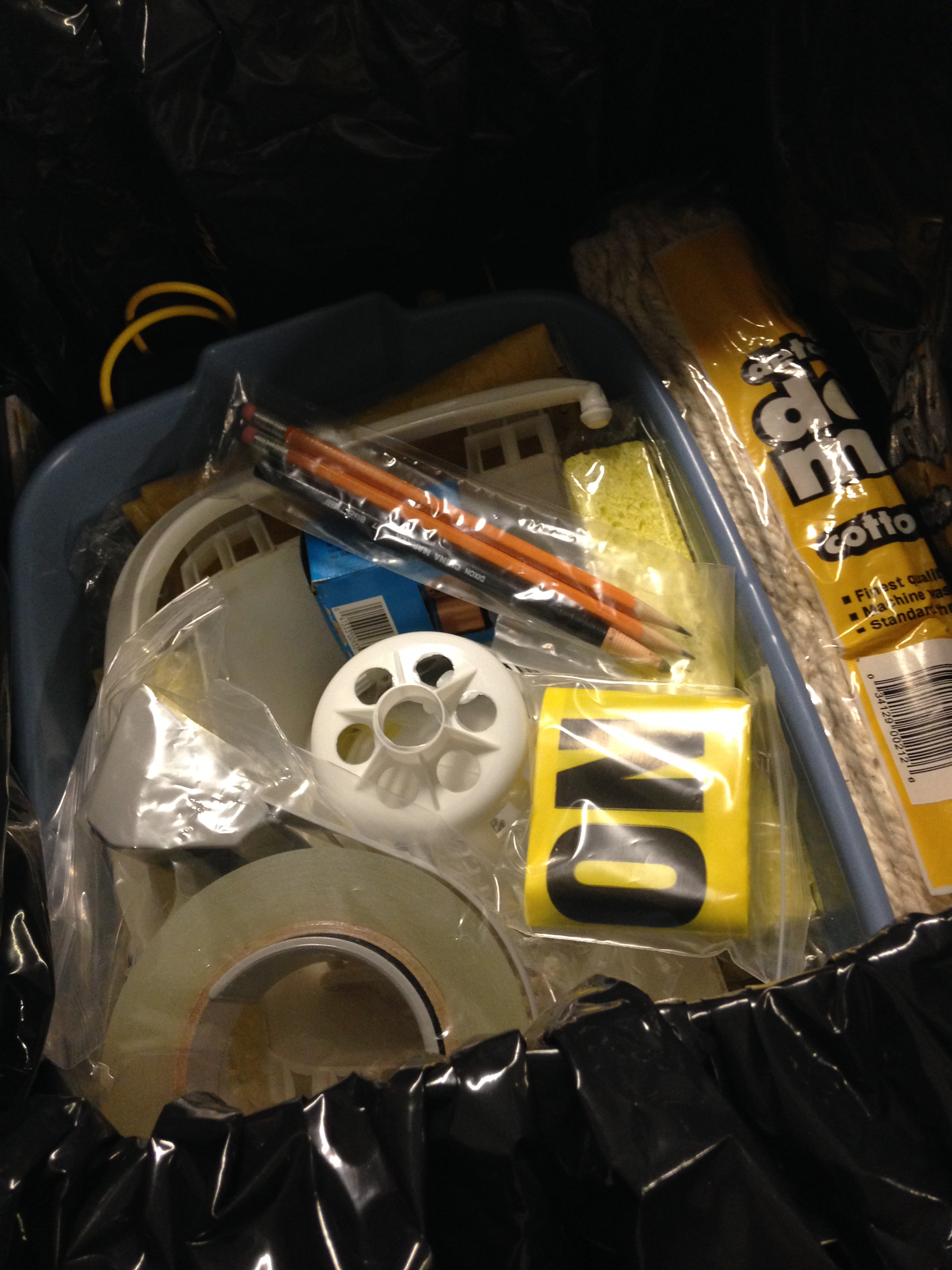 Box containing flashlights, batteries, nitrile gloves, spill pillows, absorbent paper, clipboards, p