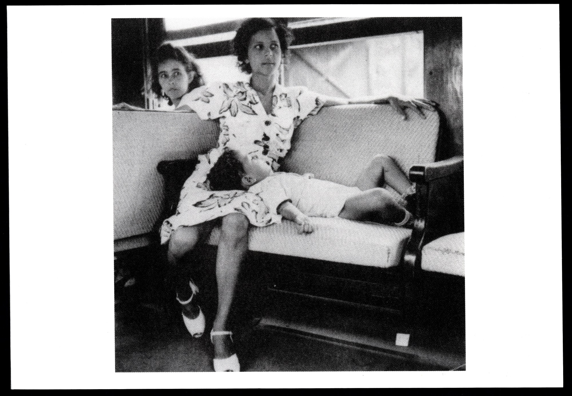 """Woman and child aboard a train"" (1946), by Jack Delano, ""The Art of Jack Delano,"" exhibition postca"