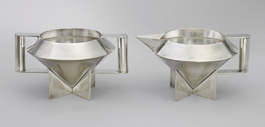 2 geometric silver vessels, one with handles on each side, one with a spout and handle