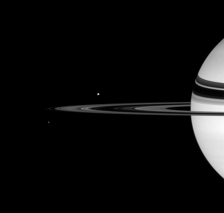 2 bright spots of light near 1/4 view of Saturn