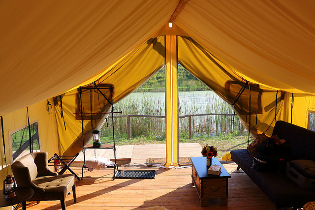 "View out the front of a ""glamping"" tent at Firelight Camps in Ithaca, NY, by Alice Crain."