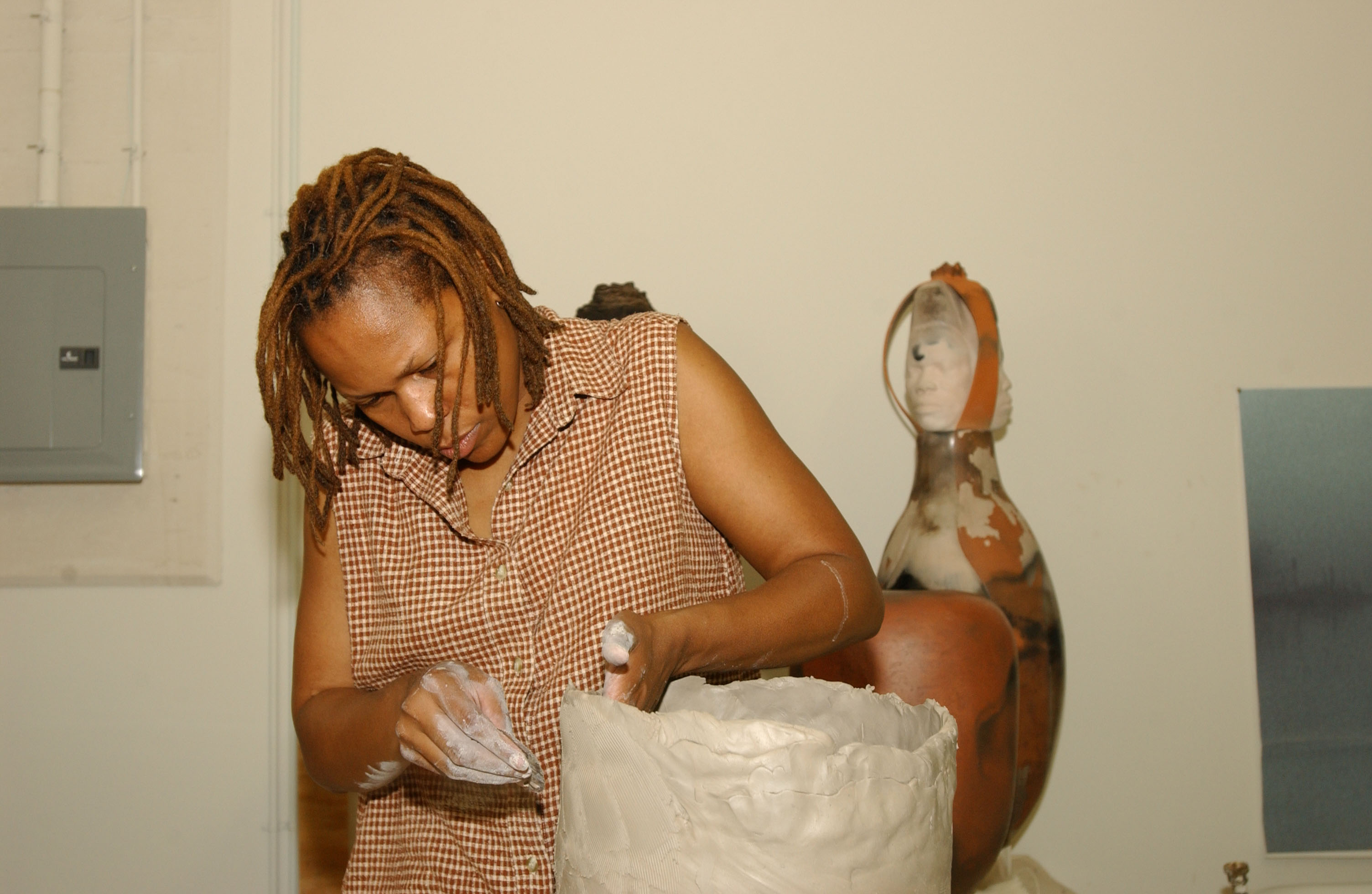 Varnell works on a clay project in a studio.