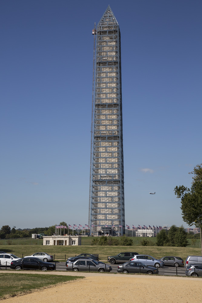The Washington Monument in 2013 surrounded by scaffolding. Repairs continue after damage from a 2011