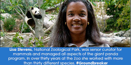 Women smiling at camera with a Giant Panda in the background to her right.