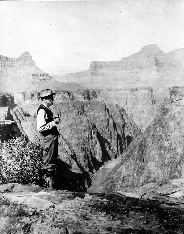 Charles Doolittle Walcott (1850-1927), paleontologist and fourth Secretary of the Smithsonian (1907-1927), stands viewing the Grand Canyon.