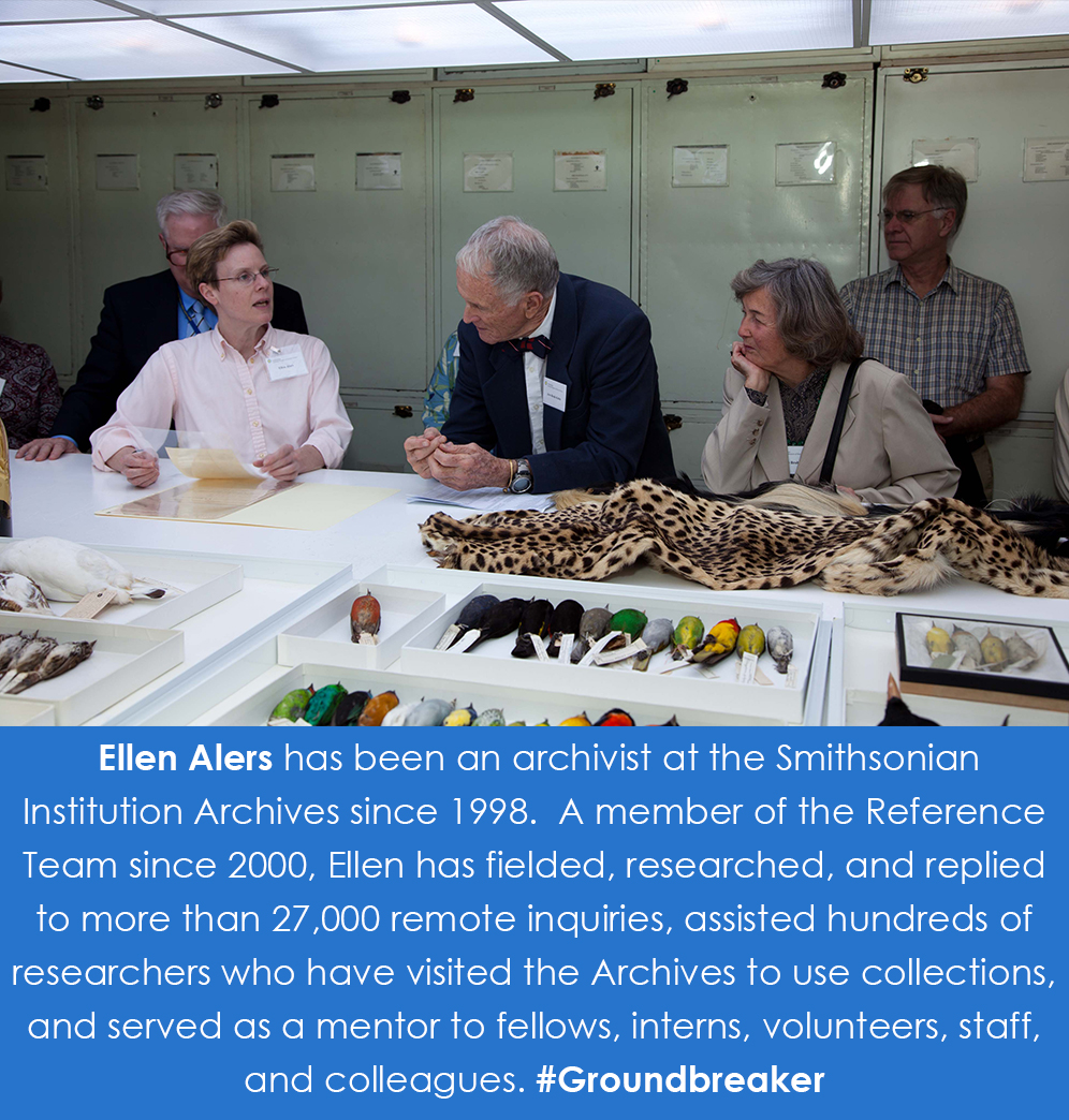 Ellen speaks to visitors on a tour of collections in the Natural History Museum Building. She is hol